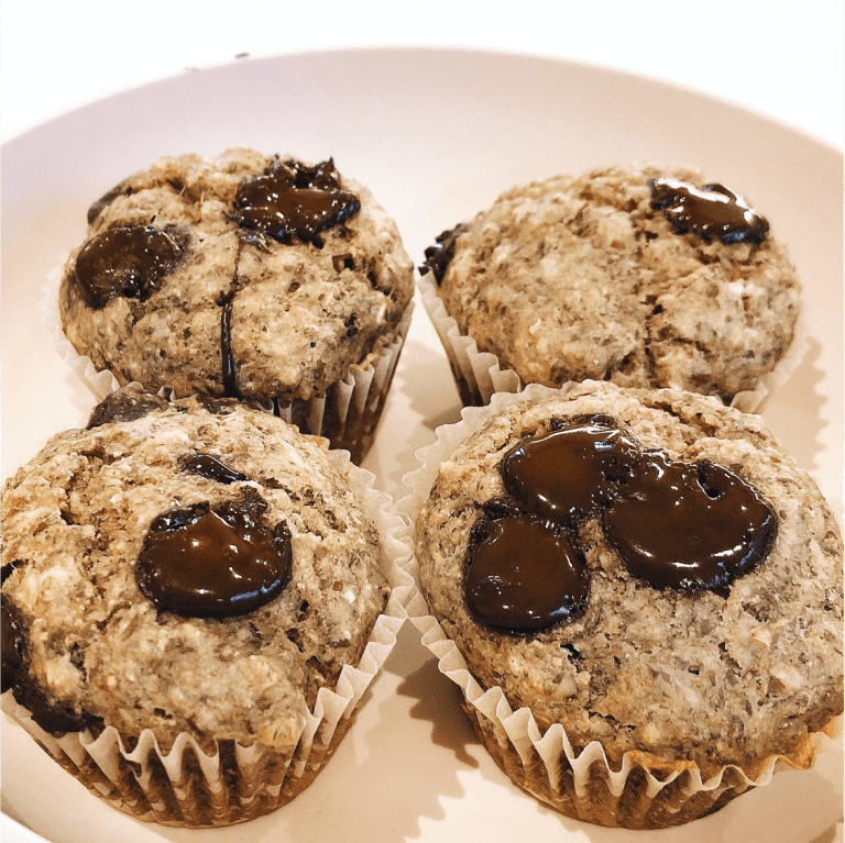 4 Banana chocolate chip oat muffins on a plate