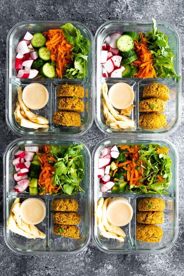 4 servings of falafel salad meal prep bowls