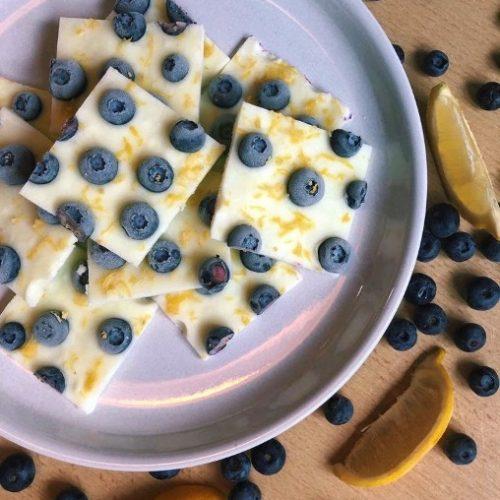 Lemon blueberry greek yogurt protein bark on a round plate