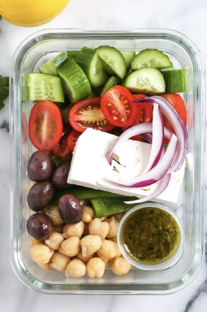 Greek chickpea salad in a rectangular glass container