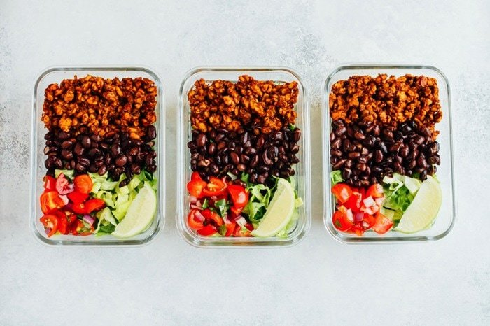 3 servings of tempeh taco salad in rectangular containers