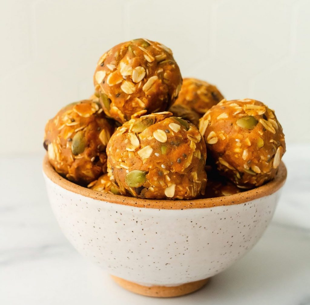 Pumpkin Cookie Protein Balls piled up in a bowl