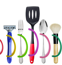 A razor, fork, spatula, spoon, and makeup brush with silicone hand mobility aids attached