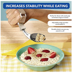 A hand scooping up a spoonful of oatmeal from a green bowl using a utensil holder with adjustable strap