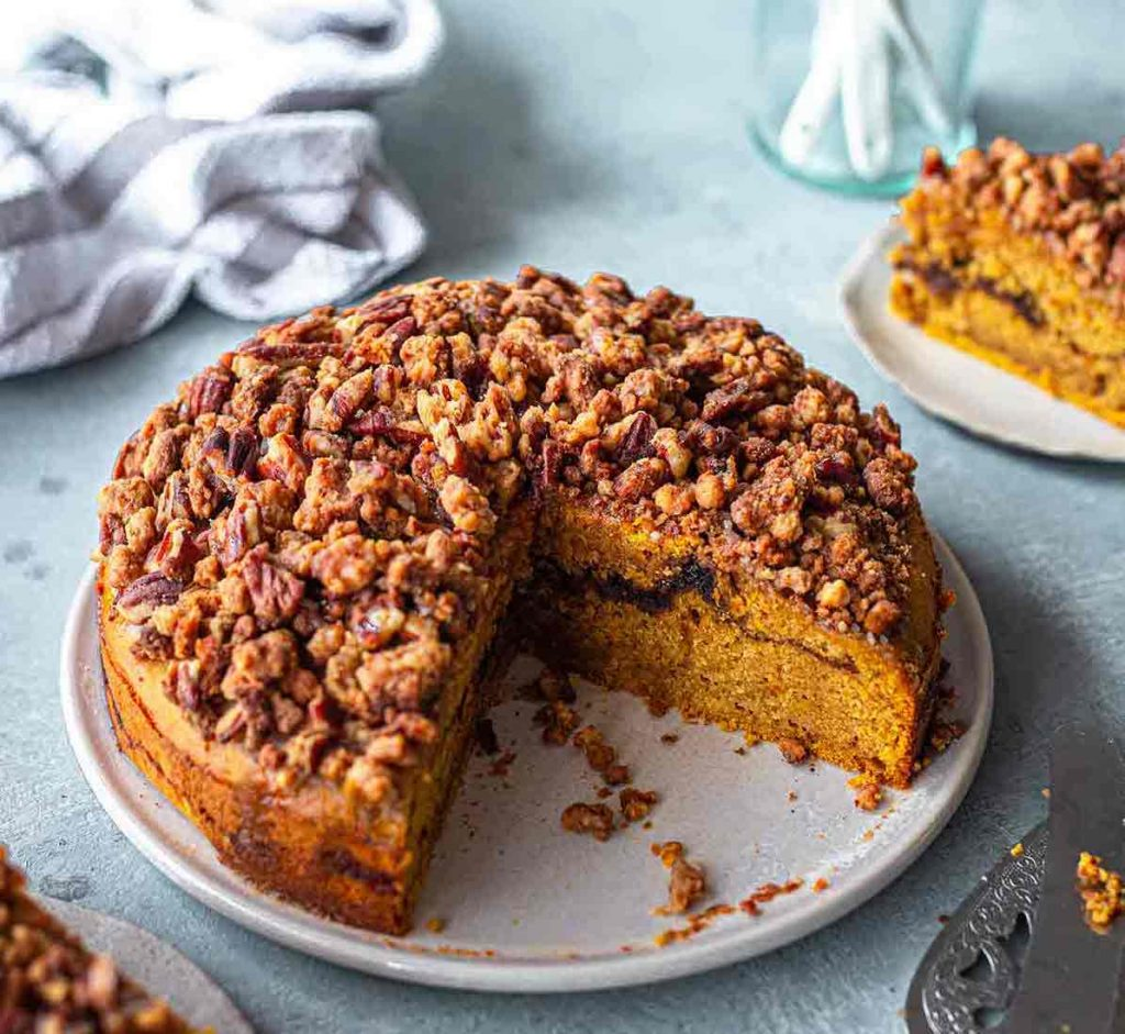 Vegan Pumpkin Coffee Cake on a plate with a slice cut out